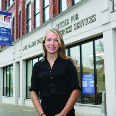 Maria is shown at the Lima/Allen County Chamber of Commerce where she spent her time interning. Her internships experience helped to prepare her for her new job once she graduated in Spring 2015.