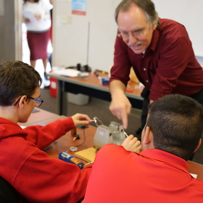 South Middle School students in a hands-on Physics lab with Ohio State Lima faculty members Tony Shoup and Sabine Jeschonnek.