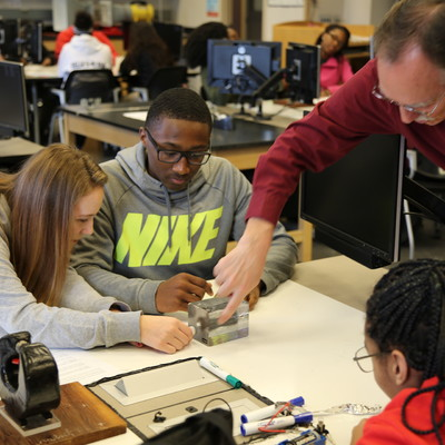 Physics lab with Lima Senior High students and Ohio State Lima faculty members Tony Shoup and Sabine Jeschonnek.