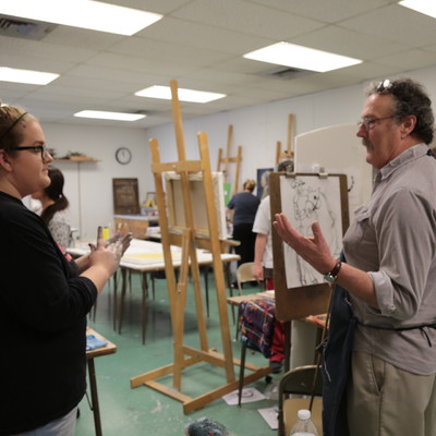 Professor of Art, Ed Valentine, assists Ohio State Lima students in his Painting 1 course.