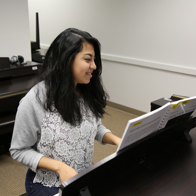 Students practice piano skills in Ohio State Lima's piano lab.