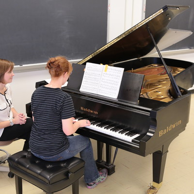 Students practice piano skills in Ohio State Lima's piano lab with Assistant Professor of Music, Margaret Young.