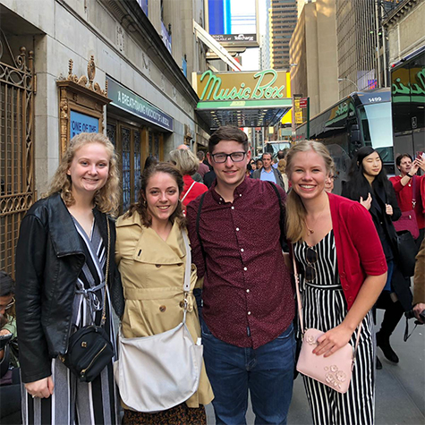 Students outside the Music Box Theatre in New York before seeing the musical Dear Evan Hansen.